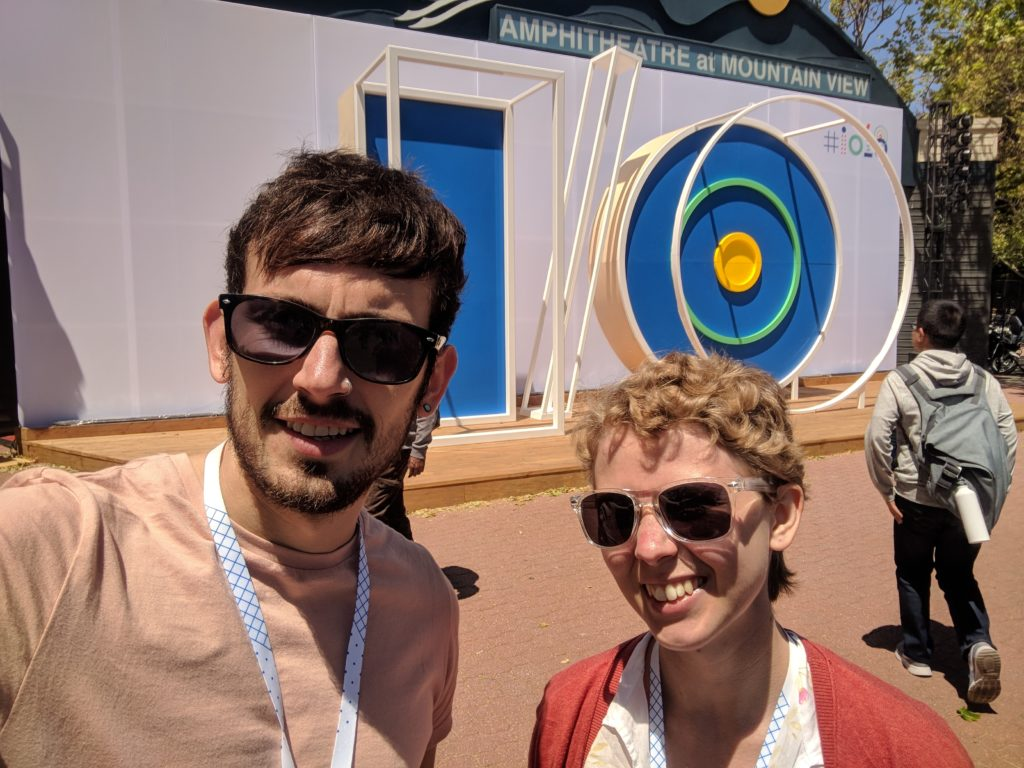Joe and Victoria at Google I/O in front of a giant IO structure